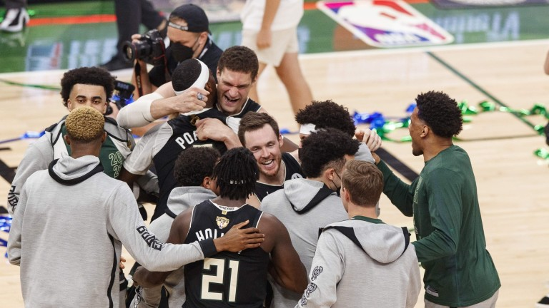 Milwaukee Bucks players celebrate wining the NBA Championship following Game 6 of the 2021 NBA Finals against the Phoenix Suns at Fiserv Forum.