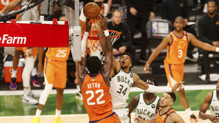 Milwaukee Bucks forward Giannis Antetokounmpo (34) defends Phoenix Suns center Deandre Ayton (22) during the fourth quarter during game four of the 2021 NBA Finals at Fiserv Forum.