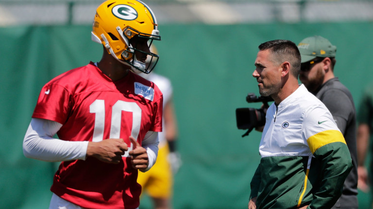 Thursday. June 10: Packers head coach Matt LaFleur engages with Jordan Love as he participates in minicamp practice in Green Bay, Wis.