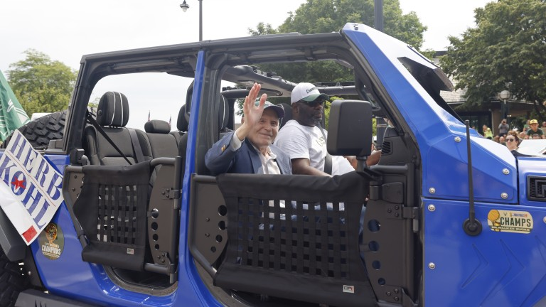 Former Senator and Bucks owner Herb Kohl rolled in style during the parade. (AP Photo/Jeffrey Phelps)