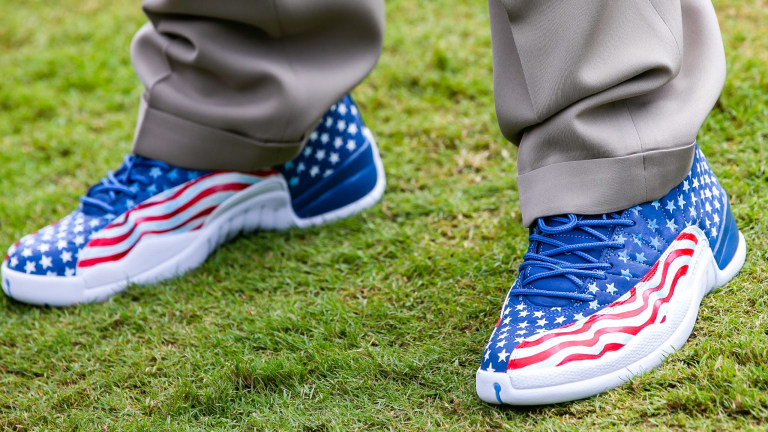 Florida head coach Dan Mullen sports patriotic shoes after the Florida Gators arrived for Gator Walk on Saturday in Tampa, Florida. (Doug Engle via Imagn Content Services, LLC)