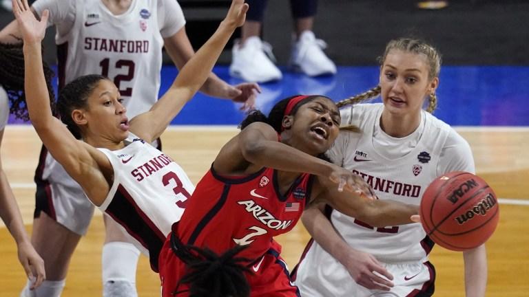Arizona's Aari McDonald passes between Stanford's Anna Wilson and Cameron Brink, right. (AP Photo/Eric Gay)