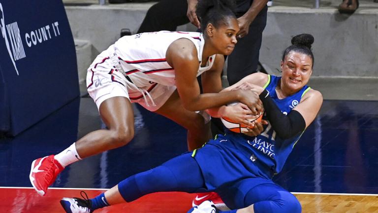 Tuesday, June 8: Washington Mystics guard Kiara Leslie and Minnesota Lynx guard Kayla McBride battle for the ball.