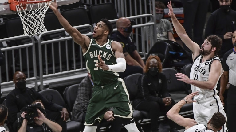 Thursday, June 10: Milwaukee Bucks forward Giannis Antetokounmpo (34) scores a basket past Brooklyn Nets forward Joe Harris.