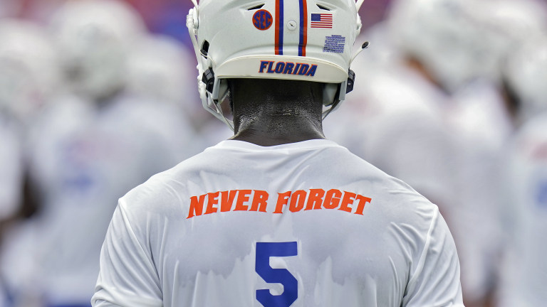 """Florida cornerback Kaiir Elam wears a """"never forget"""" t-shirt, in honor of the 20th anniversary of the Sept. 11, 2001 terrorist attacks. (AP Photo/Chris O'Meara)"""