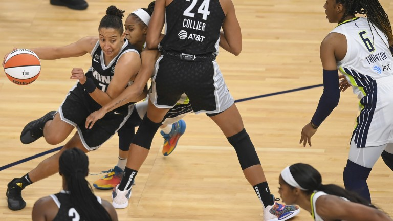 Wednesday, July 7: Layshia Clarendon works off a pick set by Napheesa Collier during Minnesota's 85-79 victory over the Dallas Wings.
