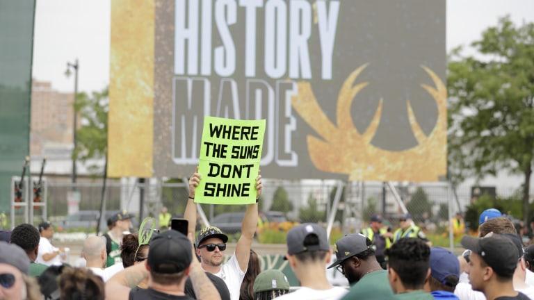 "A fan trolls the Bucks' NBA Finals foe with a ""Where the Suns Don't Shine"" sign. (AP Photo/Aaron Gash)"