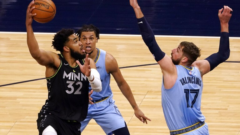 Wednesday, May 5: Timberwolves' Karl-Anthony Towns shoots as Memphis Grizzlies' Jonas Valanciunas defends.