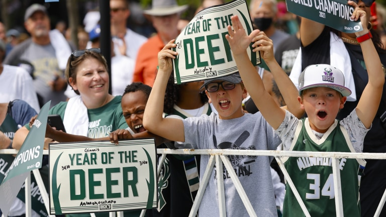 Fans young and old came out to celebrate in downtown Milwaukee. (AP Photo/Jeffrey Phelps)