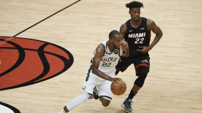 Khris Middleton (22) dribbles the ball against Miami Heat forward Jimmy Butler (22) during the fourth quarter of game four in the first round of the 2021 NBA Playoffs at American Airlines Arena. Mandatory Credit: Sam Navarro-USA TODAY Sports