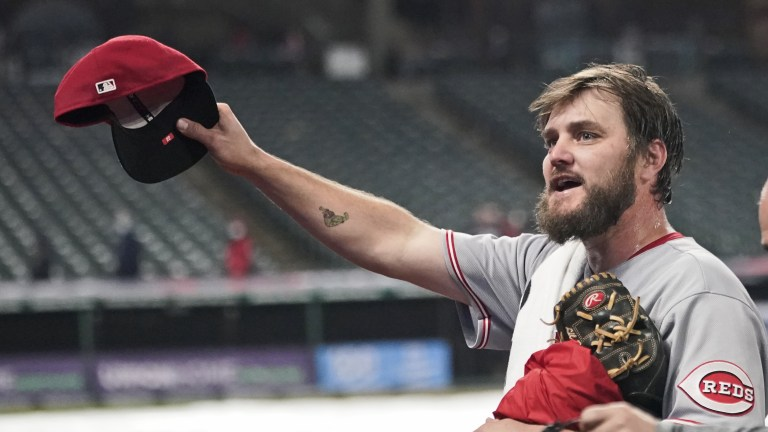 Cincinnati Reds starting pitcher Wade Miley tips his cap to fans after pitching a no-hitter against the Cleveland Indians in a baseball game, Friday, May 7, 2021, in Cleveland. (AP Photo/Tony Dejak)