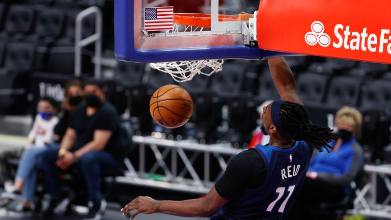 Tuesday, May 11: Timberwolves center Naz Reid dunks the ball against the Pistons.