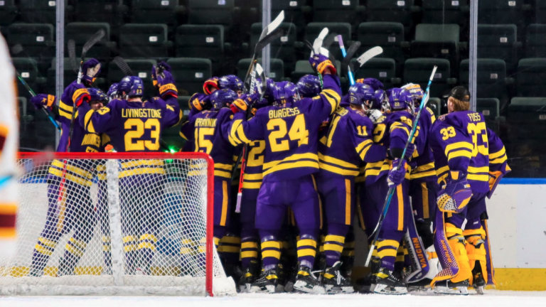 Sunday, March 28: The Minnesota State men's hockey team celebrates a 4-0 victory over the Minnesota Gophers in the West Regional Final, which propelled the Mavericks to their first Frozen Four appearance in program history. (Photo courtesy MSU Mavericks.)
