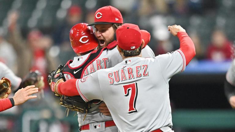 Cincinnati Reds starting pitcher Wade Miley, catcher Tucker Barnhart and third baseman Eugenio Suarez celebrate after Miley threw a no-hitter. Mandatory Credit: Ken Blaze-USA TODAY Sports