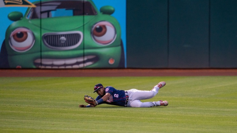 Tuesday, April 20: Twins left fielder Luis Arraez makes a diving catch against the Oakland Athletics.