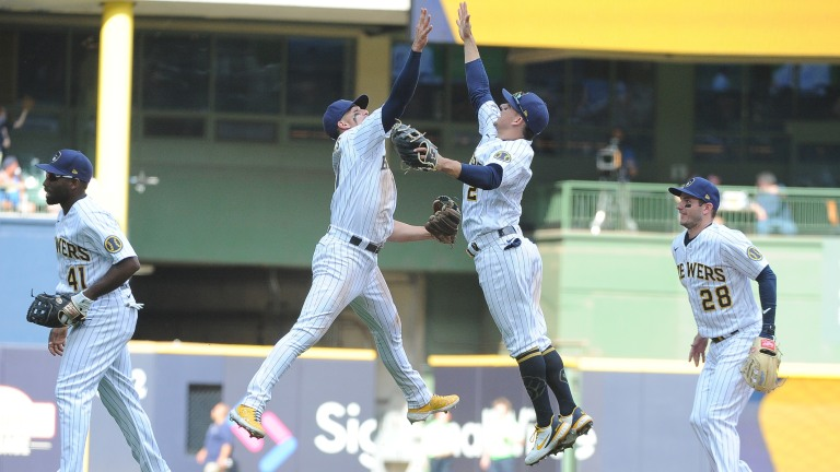 Sunday, June 6: Brewers shortstop Willy Adames (27) and Milwaukee Brewers third baseman Luis Urias (2) high-five after their 2-0 win over the Arizona Diamondbacks at American Family Field.