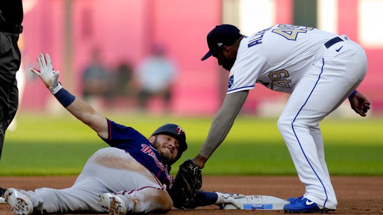 Friday, July 2: Twins' Josh Donaldson beats the tag by Kansas City Royals second baseman Hanser Alberto after hitting a double.