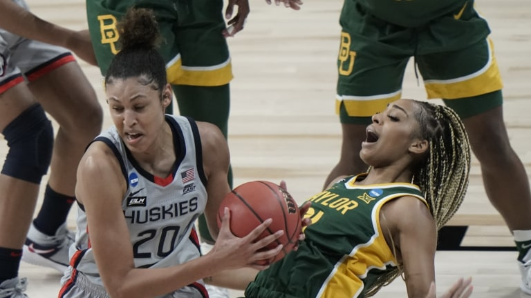 Baylor's DiJonai Carrington draws a charge on UConn's Olivia Nelson-Ododa. (AP Photo/Morry Gash)