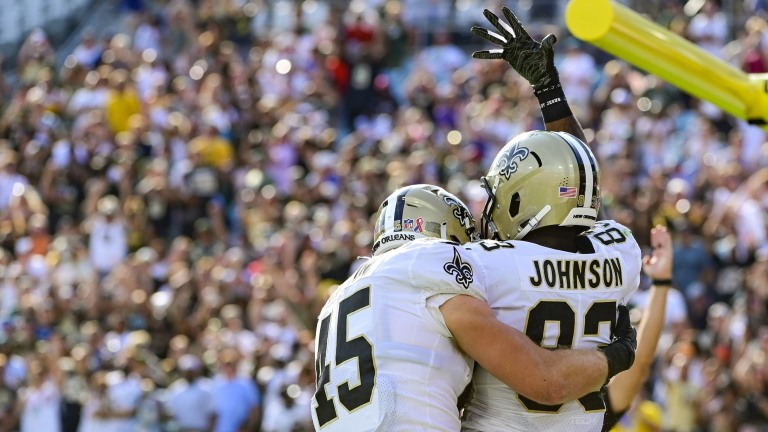 New Orleans Saints tight end Juwan Johnson celebrates with teammates after scoring a second quarter touchdown against the Green Bay Packers at TIAA Bank Field.