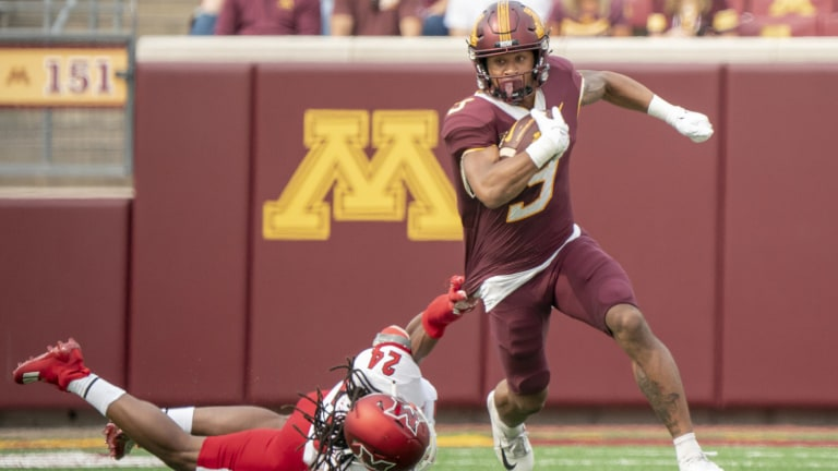 Minnesota Golden Gophers wide receiver Daniel Jackson breaks the tackle of Miami (OH) Redhawks defensive back Ja'don Rucker-Furlow in the second quarter at Huntington Bank Stadium.
