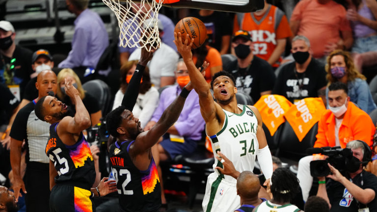 Bucks forward Giannis Antetokounmpo (34) attempts to shoot the ball as Phoenix Suns center Deandre Ayton (22) defends in the first quarter during Game 5.