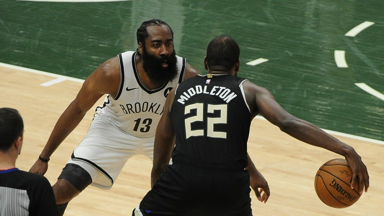 James Harden (13) guards Milwaukee Bucks forward Khris Middleton (22) in the fourth quarter during game six in the second round of the 2021 NBA Playoffs at Fiserv Forum. Mandatory Credit: Michael McLoone-USA TODAY Sports