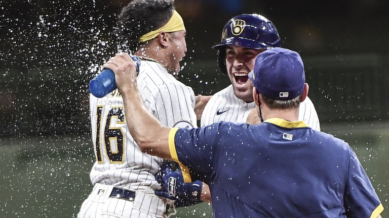 Saturday, May 1: Brewers infielders Kolten Wong and Travis Shaw celebrate after Shaw hit a walk-off single into right field against the defending champs in the 11th-inning.