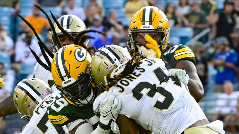 Green Bay Packers linebacker De'Vondre Campbell hits New Orleans Saints running back Tony Jones Jr. during the fourth quarter at TIAA Bank Field.