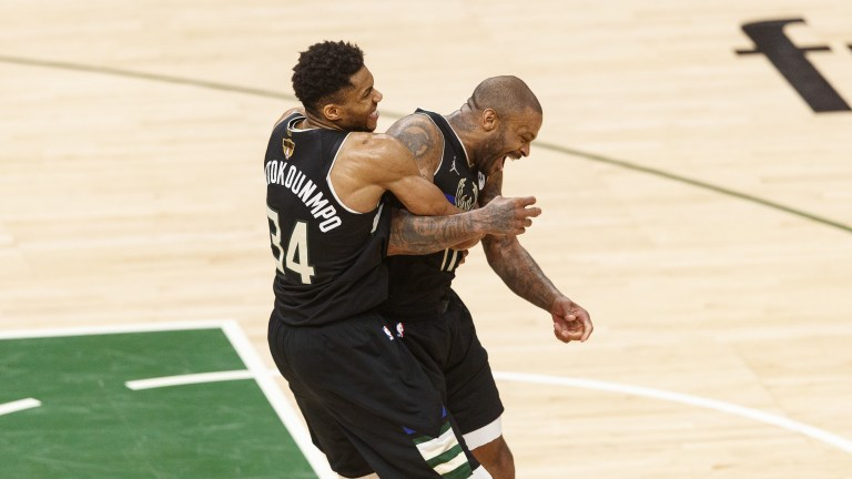 Jul 20, 2021; Milwaukee, Wisconsin, USA; Milwaukee Bucks forward Giannis Antetokounmpo (34) celebrates with forward P.J. Tucker (17) during the fourth quarter against the Phoenix Suns during game six of the 2021 NBA Finals at Fiserv Forum. Mandatory Credit: Jeff Hanisch-USA TODAY Sports