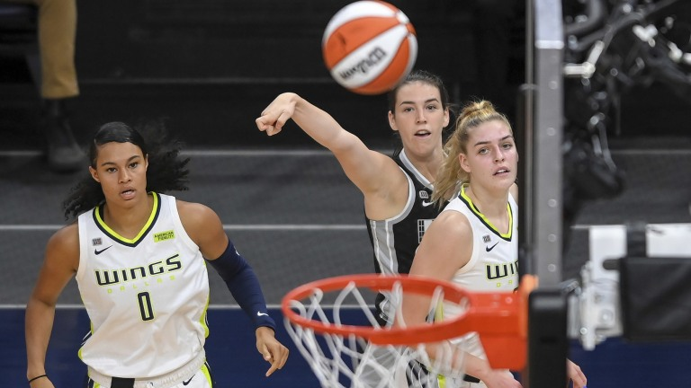 Wednesday, July 7: Bridget Carleton splashes a trey for three of her 10 points in the Minnesota Lynx's 85-79 win over Dallas.