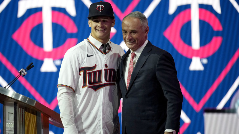 Sunday, July 11: High school right-handed pitcher Chase Petty takes a picture with MLB commissioner Rob Manfred after being selected No. 26 overall by the Minnesota Twins in the 2021 draft.