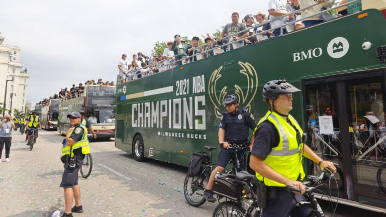 Milwaukee Bucks president Peter Feigen, upper right, pumps up the crowd. (AP Photo/Jeffrey Phelps)