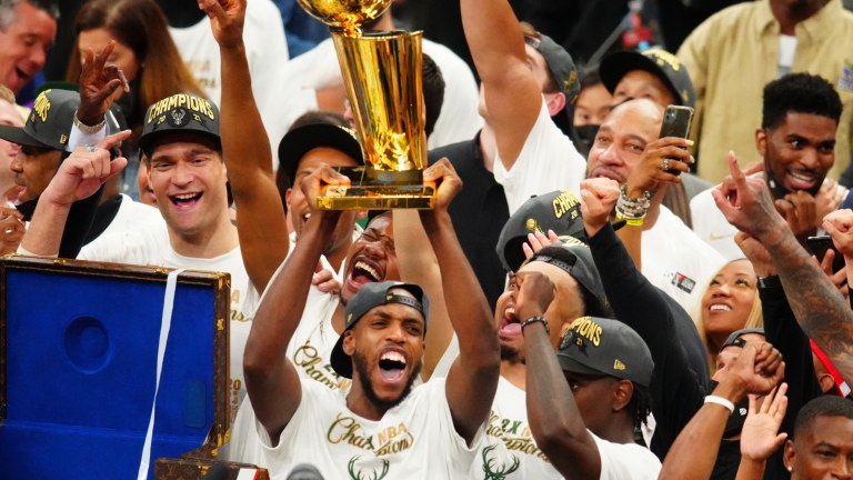 Jul 20, 2021; Milwaukee, Wisconsin, USA; Milwaukee Bucks forward Khris Middleton (22) celebrates with the Larry O'Brien Trophy after game six of the 2021 NBA Finals and the championship against the Phoenix Suns at Fiserv Forum. Mandatory Credit: Mark J. Rebilas-USA TODAY Sports