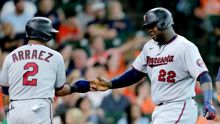Sunday, Aug. 8: Twins first baseman Miguel Sano (22, right) is congratulated by Minnesota Twins third baseman Arraez (2, left) after hitting a two-run home run against the Houston Astros.