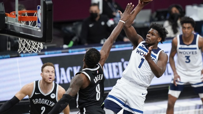 Monday, March 29: Minnesota Timberwolves guard Anthony Edwards shoots a floater against the Brooklyn Nets.