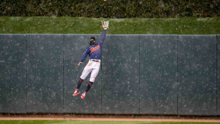 Tuesday, April 13: Twins center fielder Byron Buxton jumps up and attempts to catch a home run by the Boston Red Sox at Target Field.