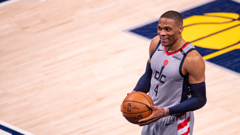May 8, 2021; Indianapolis, Indiana, USA; Washington Wizards guard Russell Westbrook (4) reacts after stopping the Indiana Pacers during an overtime period of an NBA basketball game at Bankers Life Fieldhouse. Mandatory Credit: Doug McSchooler-USA TODAY Sports