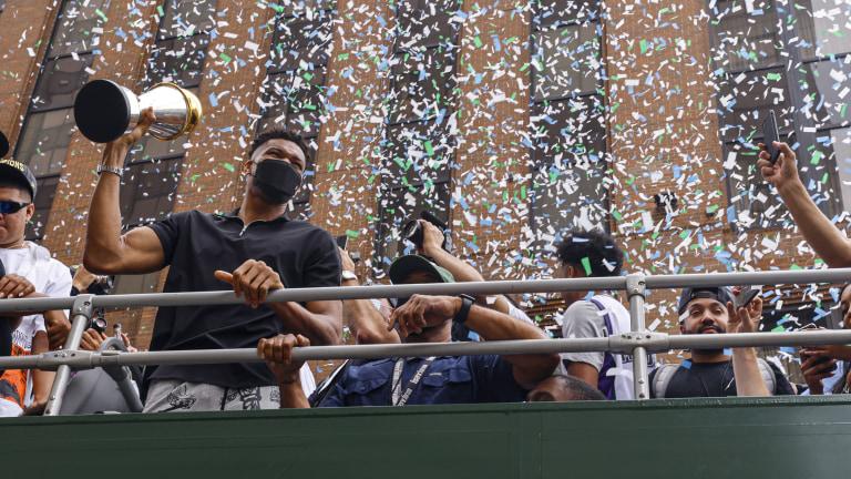 Giannis Antetokounmpo shows fans the MVP trophy. (AP Photo/Jeffrey Phelps)