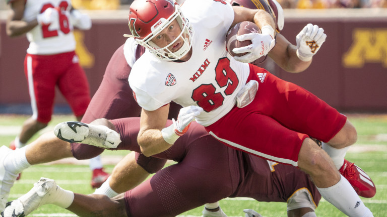 Miami (OH) Redhawks tight end Jack Coldiron falls forward after being tackled by Minnesota Golden Gophers offensive lineman Karter Shaw and defensive back Michael Dixon at Huntington Bank Stadium.