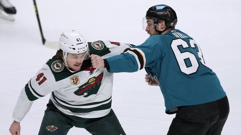 Monday, March 29: Minnesota Wild center Luke Johnson fights with San Jose Sharks left wing Jeffrey Truchon-Viel.