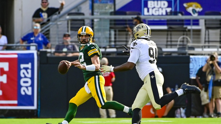 Green Bay Packers quarterback Aaron Rodgers rolls out to pass during the first quarter against the New Orleans Saints at TIAA Bank Field.