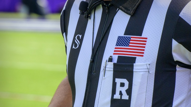 A view of a USA flag on the uniform of a referee before the game between the TCU Horned Frogs and the California Golden Bears at Amon G. Carter Stadium. (Jerome Miron-USA TODAY Sports)