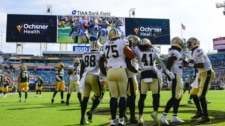 New Orleans Saints running back Alvin Kamara reacts after scoring a second quarter touchdown against the Green Bay Packers at TIAA Bank Field.