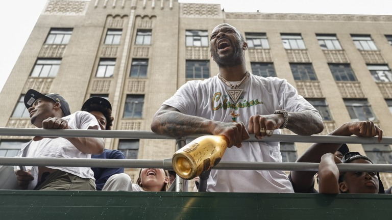 Milwaukee Bucks forward P.J. Tucker celebrates during the team's victory parade.