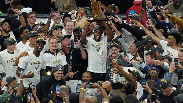 The Milwaukee Bucks celebrate with the championship trophy after defeating the Phoenix Suns in Game 6 of basketball's NBA Finals in Milwaukee, Tuesday, July 20, 2021. The Bucks won 105-98. (AP Photo/Paul Sancya)