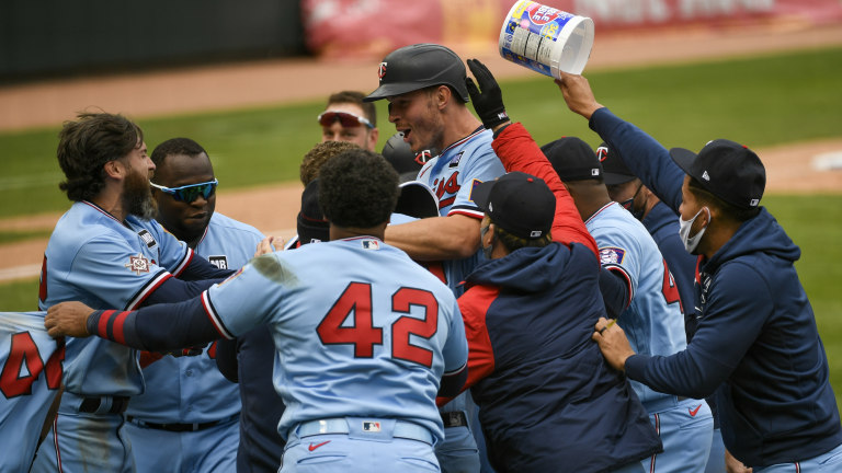 Thursday, April 15: Minnesota Twins' Max Kepler, center with helmet, celebrates with his team after driving in the winning run in the ninth inning of a baseball game against the Boston Red Sox.