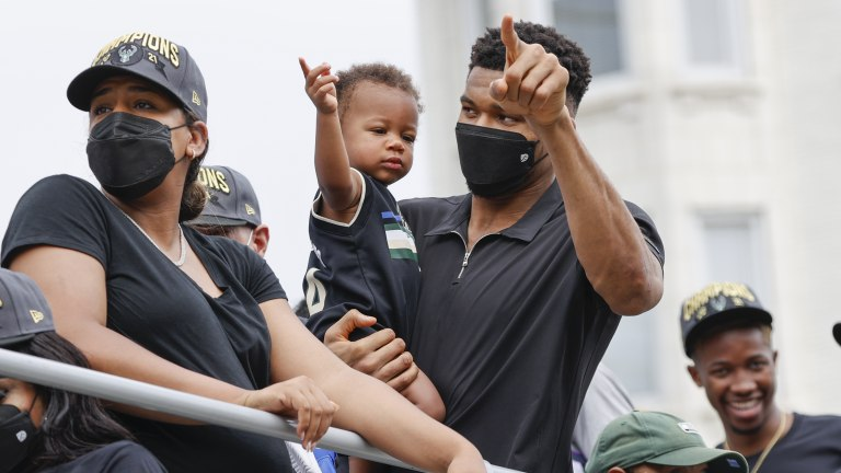 Giannis Antetokounmpo, right, and girlfriend Mariah Riddlesprigger celebrate with son Liam. (AP Photo/Jeffrey Phelps)