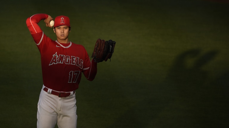 May 5, 2021; Anaheim, California, USA; Los Angeles Angels starting pitcher Shohei Ohtani (17) tosses the baseball during the first inning against the Tampa Bay Rays at Angel Stadium. Mandatory Credit: Kelvin Kuo-USA TODAY Sports