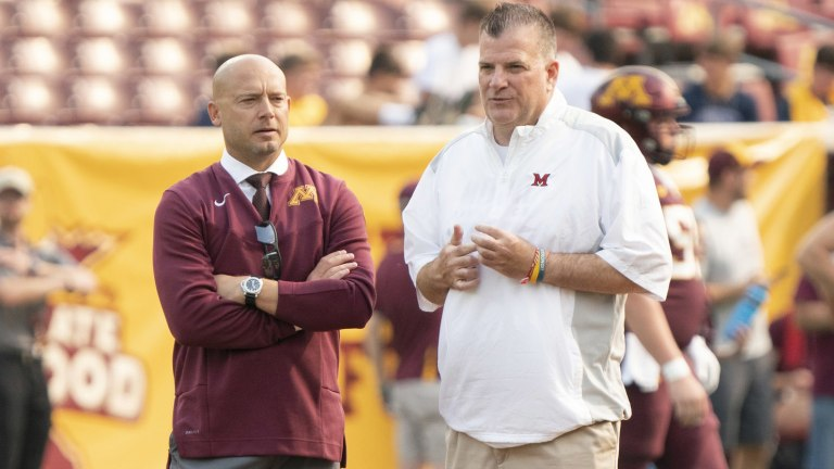 Minnesota Golden Gophers head coach P.J. Fleck and Miami (OH) Redhawks head coach Chuck Martin chat at midfield prior to the game at Huntington Bank Stadium.