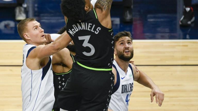 Wednesday, March 24: Minnesota Timberwolves' forward Jaden McDaniels leaps to throw down a dunk against the Dallas Mavericks.